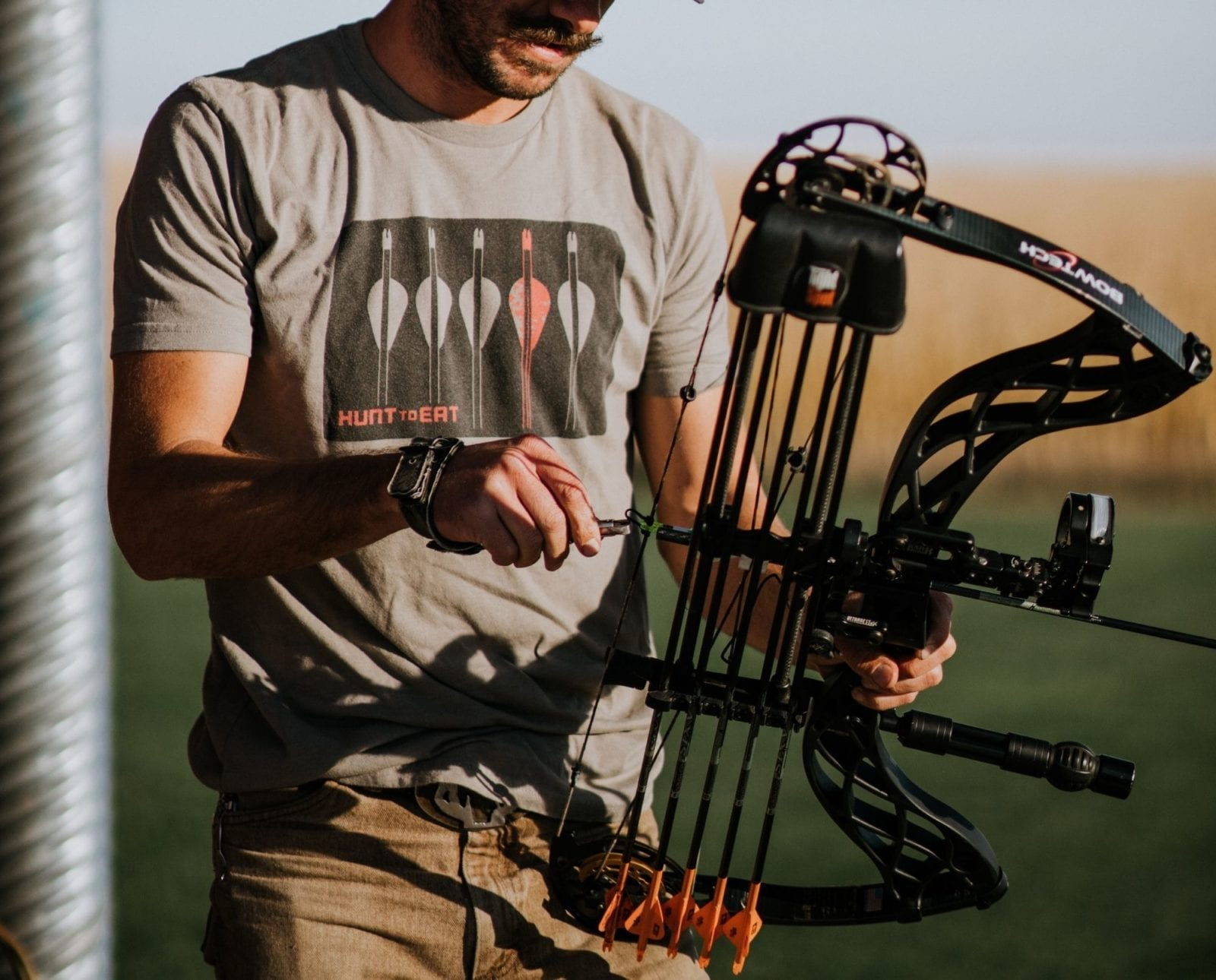 A bowhunter nocks an arrow while at target practice.